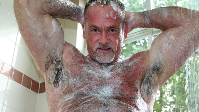 Butch-Dixon-silver-haired-hunk-older-mature-stud-Mickie-Collins-flexes-muscles-rubs-furry-tanned-skin-016-male-tube-red-tube-gallery-photo