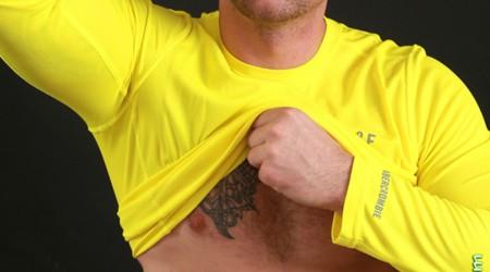 Tattooed ripped muscle boy Logan Granby strips