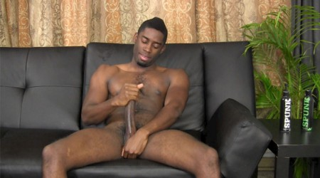 Tyler wanks his 10 inch black cock to a huge jizz shower
