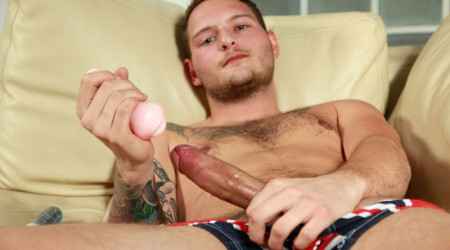 Sexy bi-sexual lad Dan Stone jerks his fat uncut cock
