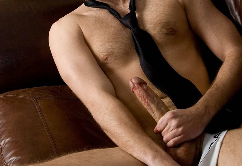Luke loses his underwear as he starts to tug hard on his big cut cock